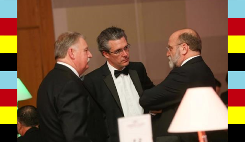 Ken Dowd and Duncan Groom of Neopost talking to Laslo Kellner of Duplo...