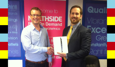 Richard Campbell of Northside Graphics accepting his iPad2 from Conor Power of Neopost Ireland...